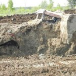 Stolen Tractor Found Buried In Manure